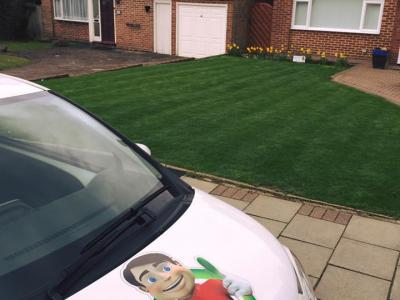 Striped Lawn With GreenThumb Van