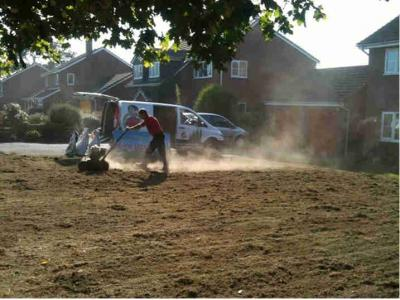 A customers lawn undergoing scarification